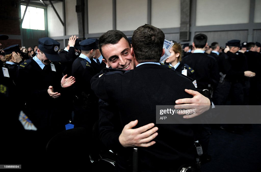 Members of the Kosovo Police (KP) congratulate each other as they take part in a graduation ceremony in the town of Vucitrn on January 18, 2013. Kosovo Academy for the Public Safety today held graduation ceremony of 44th generation of police officers (cadets) of the Kosovo Police.
