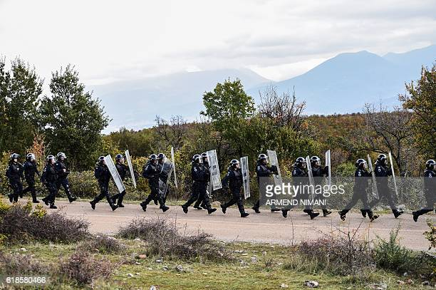 Members of the Kosovo riot police take part in a field exercise in the village of Nashec near the town of Prizren on October 27 2016 Eight members of...