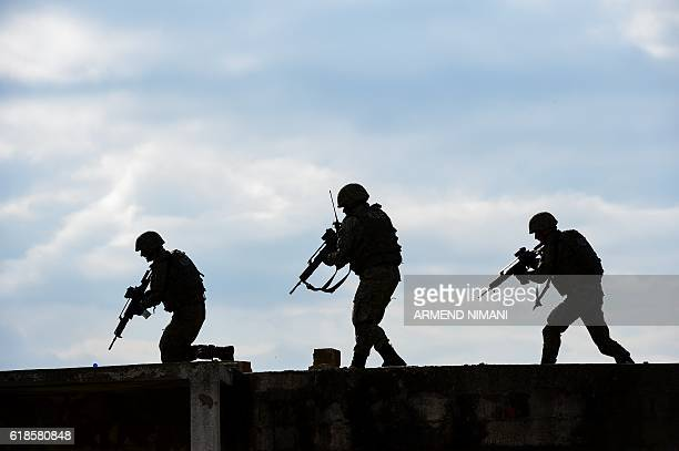Members of the Kosovo Security Force and US soldiers take part in a field exercise in the village of Nashec near the town of Prizren on October 27...