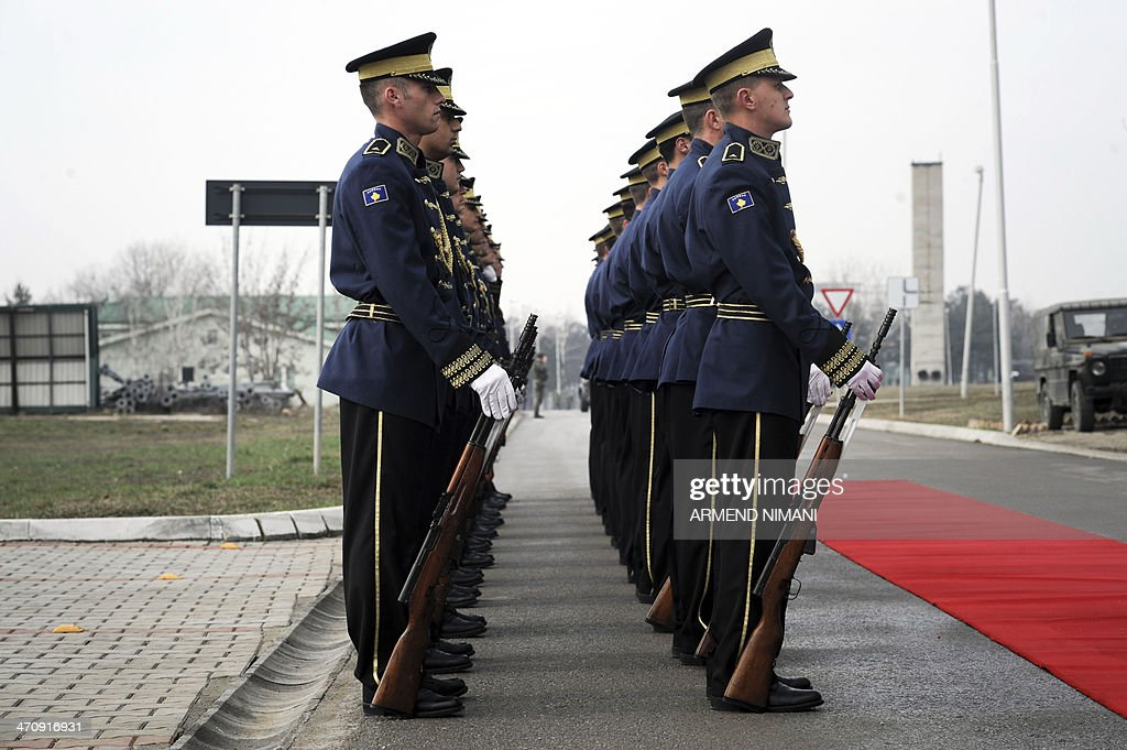 Members of the Kosovo Security Force (KSF) ceremonial guard stand at attention prior to the visit of Kosovo's Prime Minister at the Adem Jashari Barracks in Pristina on February 21, 2014. Thaci declared that there is only a short time away, weeks even months, before the Kosovo's Armed Forces will meet Euro Atlantic standards.