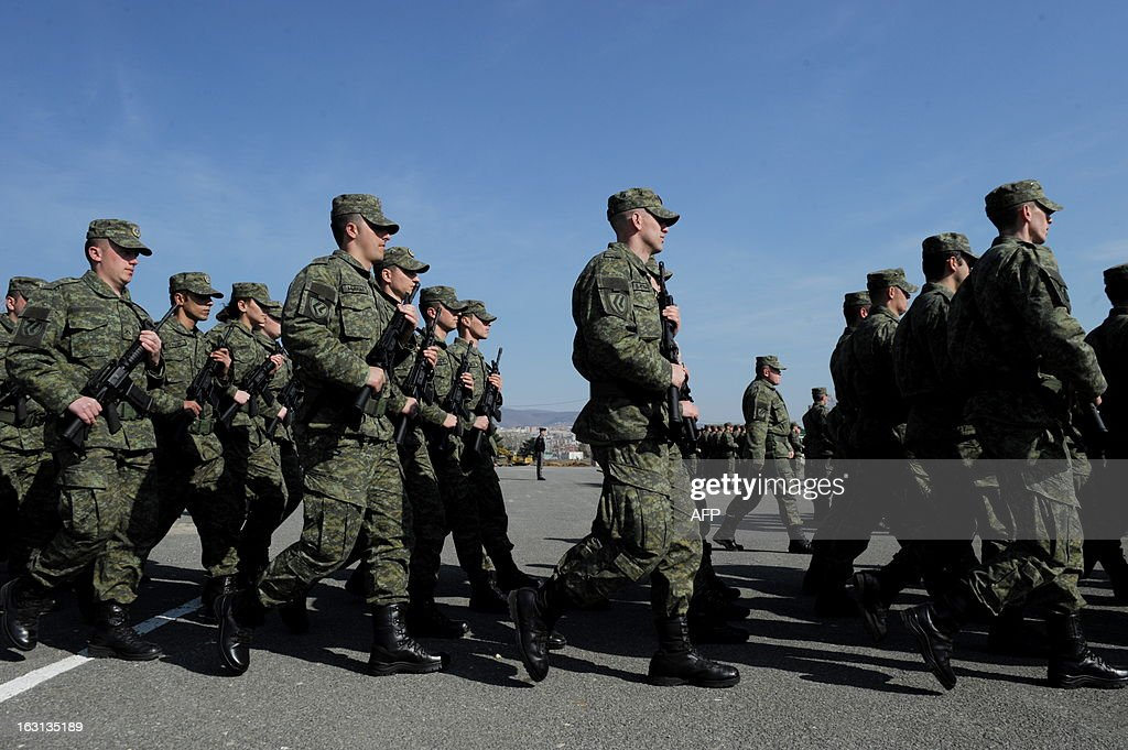 Members of the Kosovo Security Force (KSF) march during a ceremony in Pristina on March 5, 2013 marking the 15th anniversary of the killing of Kosovo Liberation Army (KLA) commander Adem Jashari. Jashari was among 45 members of his family killed by Serb security forces in the vilage of Prekaz some 40 kms west of the Kosovo capital Pristina, sparking a full-blown rebel insurgency.