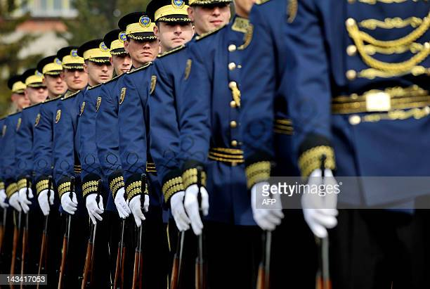 Members of the Kosovo Security Force take part in a ceremony in Pristina on March 5 2012 marking the 14th anniversary of the killing of Kosovo...