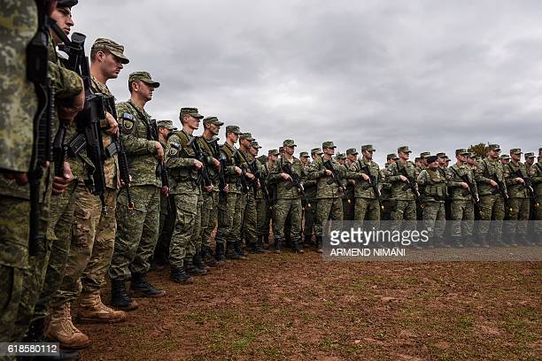 Members of the Kosovo Security Force take part in a field exercise in the village of Nashec near the town of Prizren on October 27 2016 Eight members...