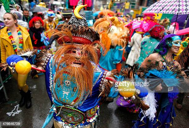 Members of the Krew of Mondo Kayo Social Marching Club parde Mardi Gras day in the rain on March 4 2014 in New Orleans Louisiana
