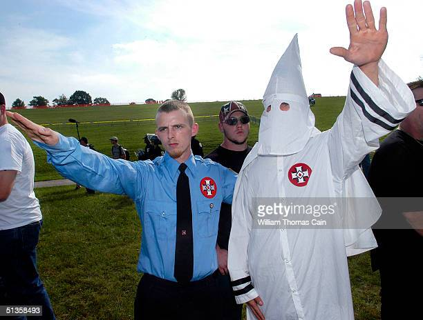 Members of the Ku Klux Klan salutes during American Nazi Party rally at Valley Forge National Park September 25 2004 in Valley Forge Pennsylvania...