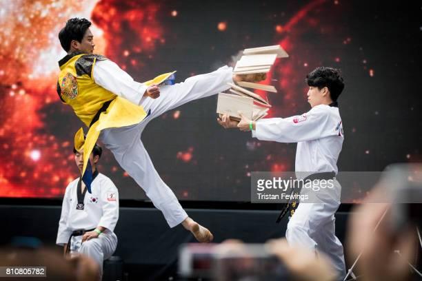 Members of the Kukkiwon Taekwondo Team perform a Taekwondo demonstration during the London Korean Festival 2017 at Olympia London on July 8 2017 in...