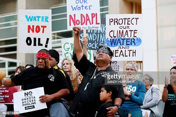 Members of the Kupa Indian Tribe from Pala Indian reservation hold signs during a rally on September 13 2016 in San Diego California in support for...