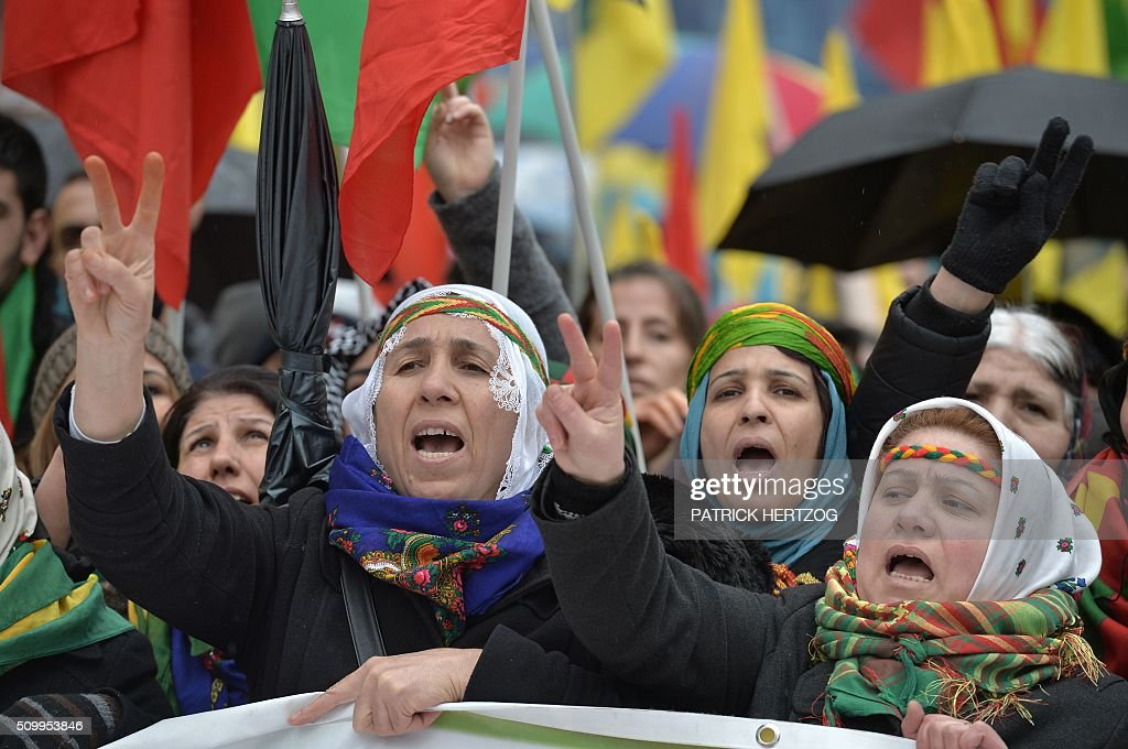 Members of the Kurdish community flash the v for victory sign on February 13, 2016, in Strasbourg, eastern France, during the annual rally of Kurds from all over Europe to denounce the detention of jailed leader of Turkey's Kurd rebels, Abdullah Ocalan. Ocalan was captured by Turkish undercover agents in Kenya in 1999, brought back to Turkey and sentenced to death. His sentence was later commuted to life. / AFP / PATRICK HERTZOG