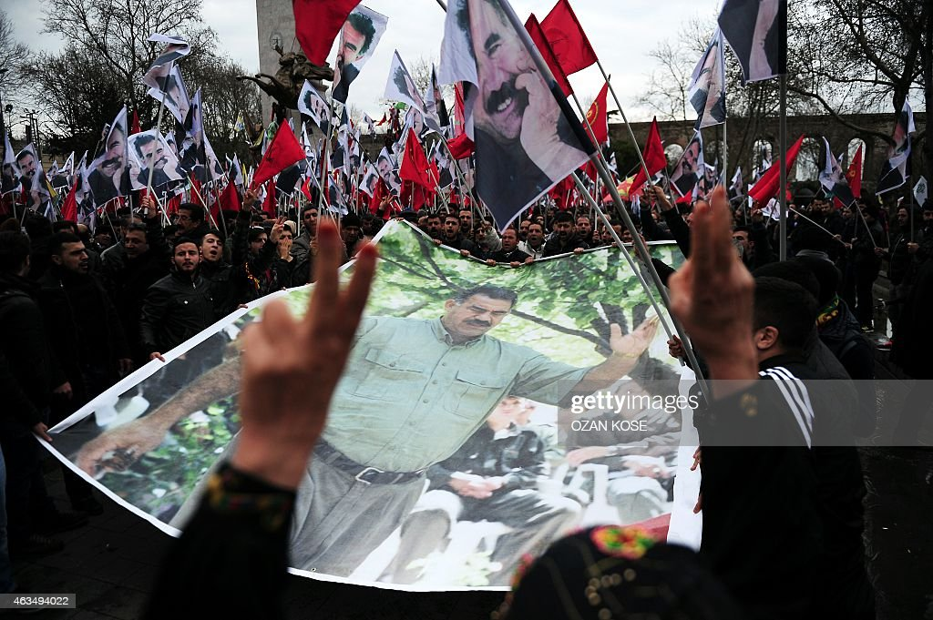 Members of the Kurdish community hold a banner depicting convicted Kurdistan Worker's Party (PKK) leader <a gi-track='captionPersonalityLinkClicked' href=/galleries/search?phrase=Abdullah+Ocalan&family=editorial&specificpeople=658599 ng-click='$event.stopPropagation()'>Abdullah Ocalan</a> during a protest calling for Ocalan's release in Istanbul on February 15, 2015. Ocalan was captured by Turkish undercover agents in Kenya in 1999, brought back to Turkey and sentenced to death. His sentence was later commuted to life.