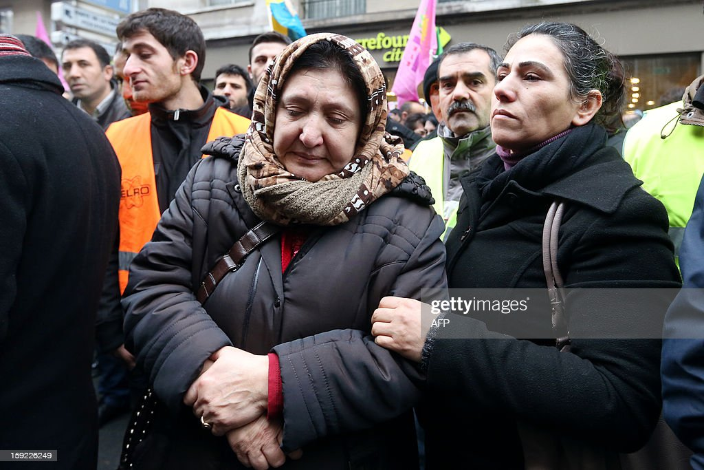 Members of the Kurdish community in France demonstrate on January 10, 2013 in Paris, near the Kurdistan Information Bureau where three Kurdish women were found killed with a gunshot to the head. The bodies of the women were found shortly before 2:00 am (0100 GMT) inside the building in the 10th arrondissement of the French capital. One of the women was 32-year-old Fidan Dogan who worked in the institute's information centre, according to its director, Leon Edart. The identities of the other two women, who were reportedly Kurdish activists but did not work at the Institute, were not immediately available. AFP PHOTO / THOMAS SAMSON