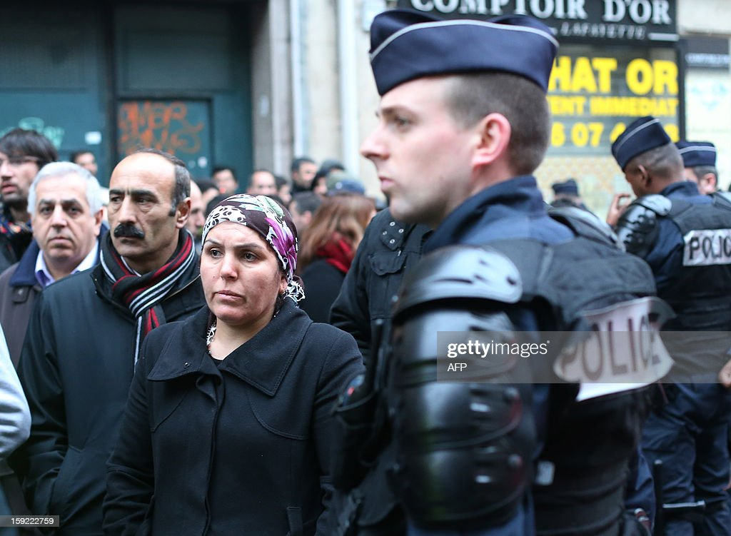Members of the Kurdish community in France stand near the Kurdistan Information Bureau in Paris on January 10, 2013, where three Kurdish women were found killed with a gunshot to the head. The bodies of the women were found shortly before 2:00 am (0100 GMT) inside the building in the 10th arrondissement of the French capital. One of the women was 32-year-old Fidan Dogan who worked in the institute's information centre, according to its director, Leon Edart. The identities of the other two women, who were reportedly Kurdish activists but did not work at the Institute, were not immediately available.