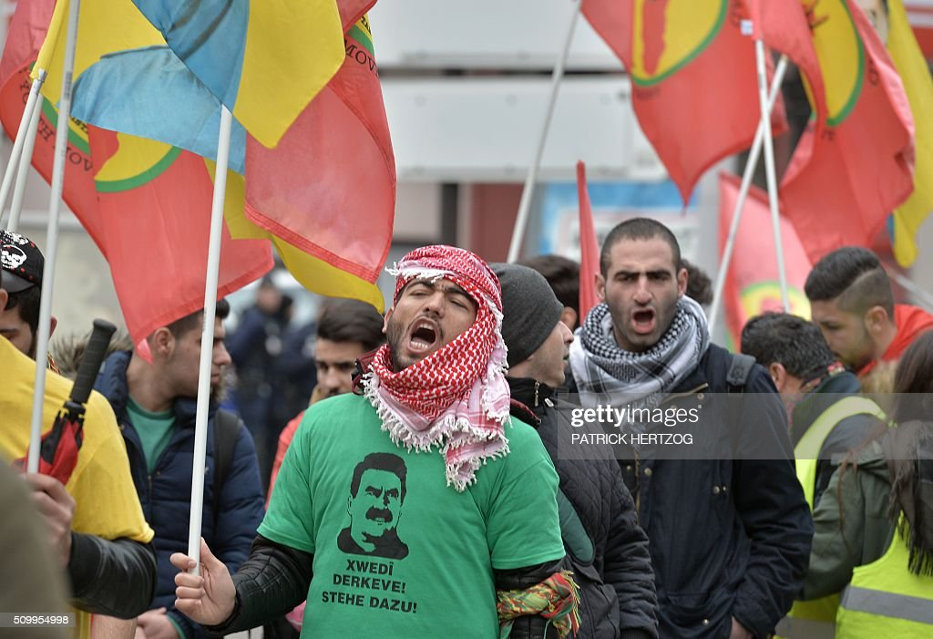 Members of the Kurdish community take part in the annual rally of Kurds from all over Europe to denounce the detention of jailed leader of Turkey's Kurd rebels, Abdullah Ocalan, on February 13, 2016, in Strasbourg, eastern France, Ocalan was captured by Turkish undercover agents in Kenya in 1999, brought back to Turkey and sentenced to death. His sentence was later commuted to life. / AFP / PATRICK HERTZOG