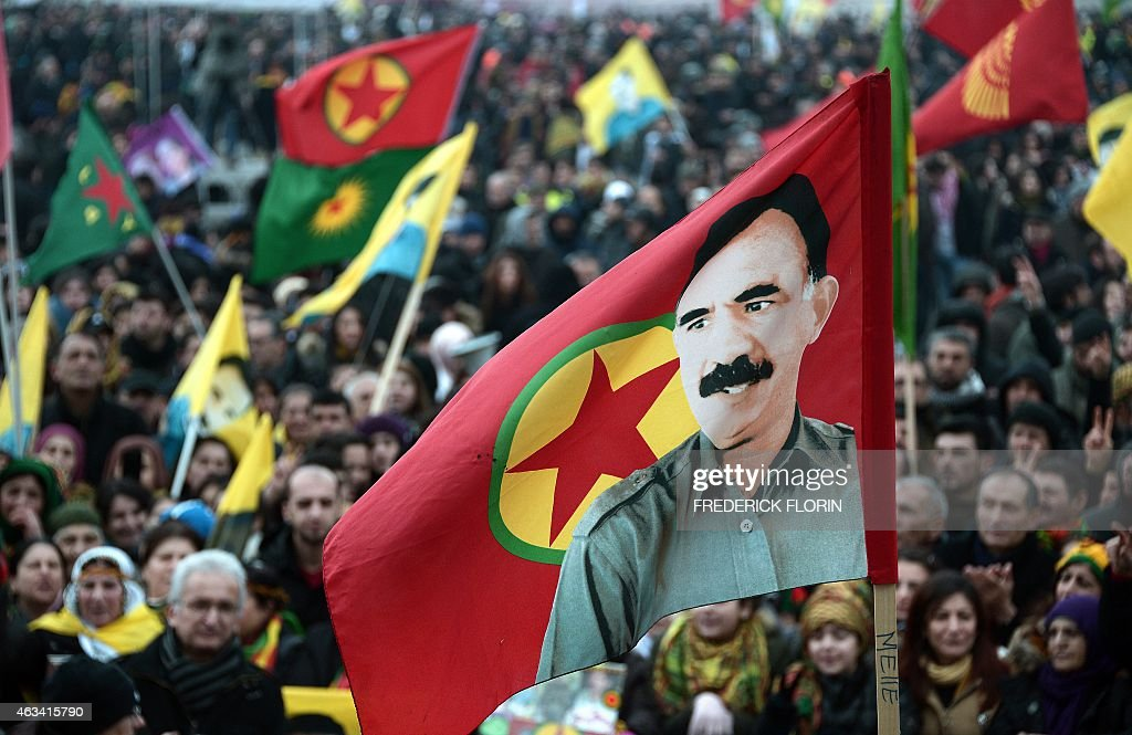 Members of the Kurdish community wave flags and banners of convicted Kurdistan Worker's Party (PKK) leader <a gi-track='captionPersonalityLinkClicked' href=/galleries/search?phrase=Abdullah+Ocalan&family=editorial&specificpeople=658599 ng-click='$event.stopPropagation()'>Abdullah Ocalan</a> during a demonstration calling for Ocalan's release in Strasbourg, Eastern France, on February 14, 2015. Ocalan was captured by Turkish undercover agents in Kenya in 1999, brought back to Turkey and sentenced to death. His sentence was later commuted to life.