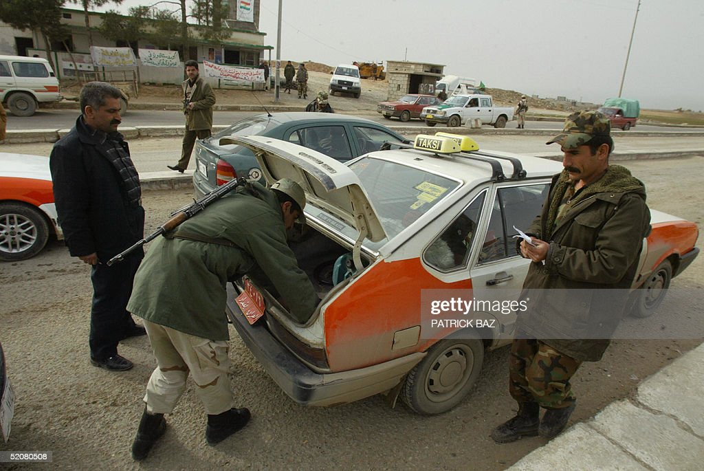 Members of the Kurdish Iraqi special police force check a taxi entering the Kurdish city of Suleimaniya 29 January 2005 Iraq closed its borders and...