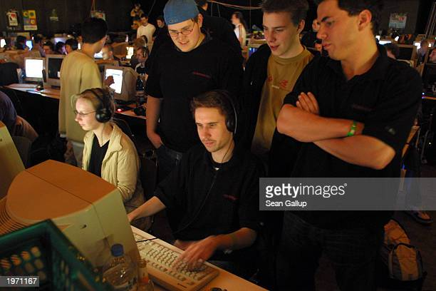 Members of the 'La Camorra' computer gaming clan watch their colleague nicknamed Trench play 'Counter Strike' during a computer gaming summit May 3...