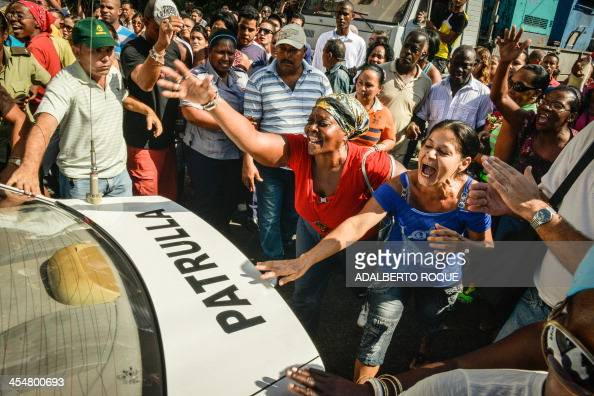 Members of the Ladies in White opposition group are arrested during a demonstration held to commemorate Human Rights Day in downtown Havana on...
