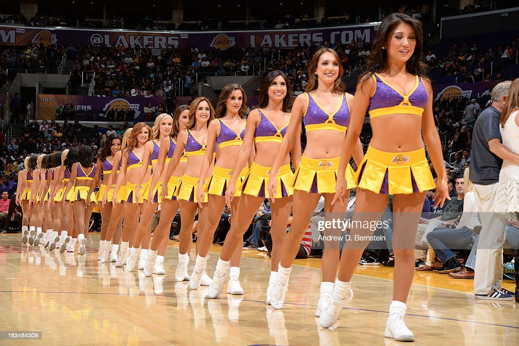 Members of the Laker Girls perform during a game between the Los Angeles Lakers and the Denver Nuggets at STAPLES Center on October 10, 2013 at in Los Angeles, California.