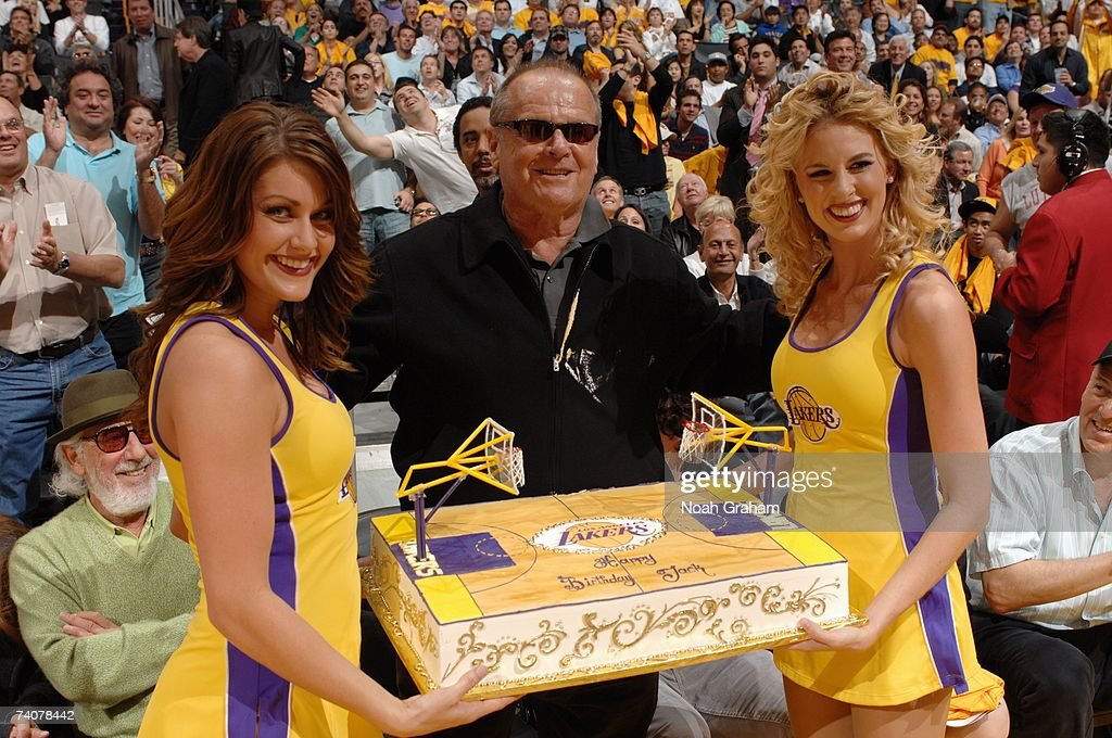 Members of the Laker Girls present a birthday cake to actor Jack Nicholson during the Los Angeles Lakers game against the Phoenix Suns in Game Three...