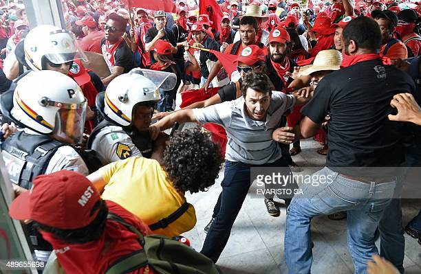 Members of the Landless Movement clash with the police during a demonstration against a fiscal adjustment and budget cuts proposed by the government...