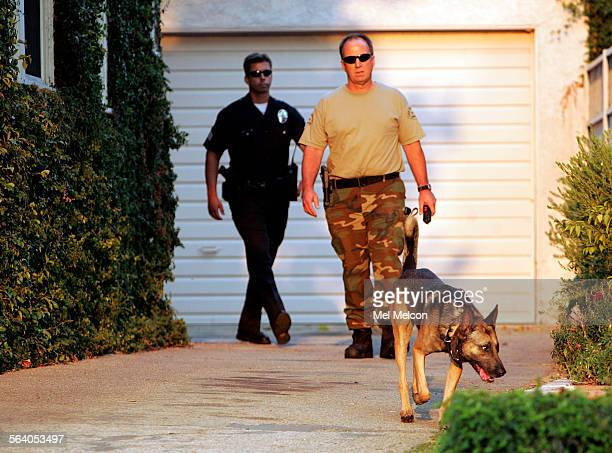 Members of the LAPD and police dog search homes along McLennan Ave near Haynes St close to Birmingham HS in Van Nuys on Wednesday afternoon September...