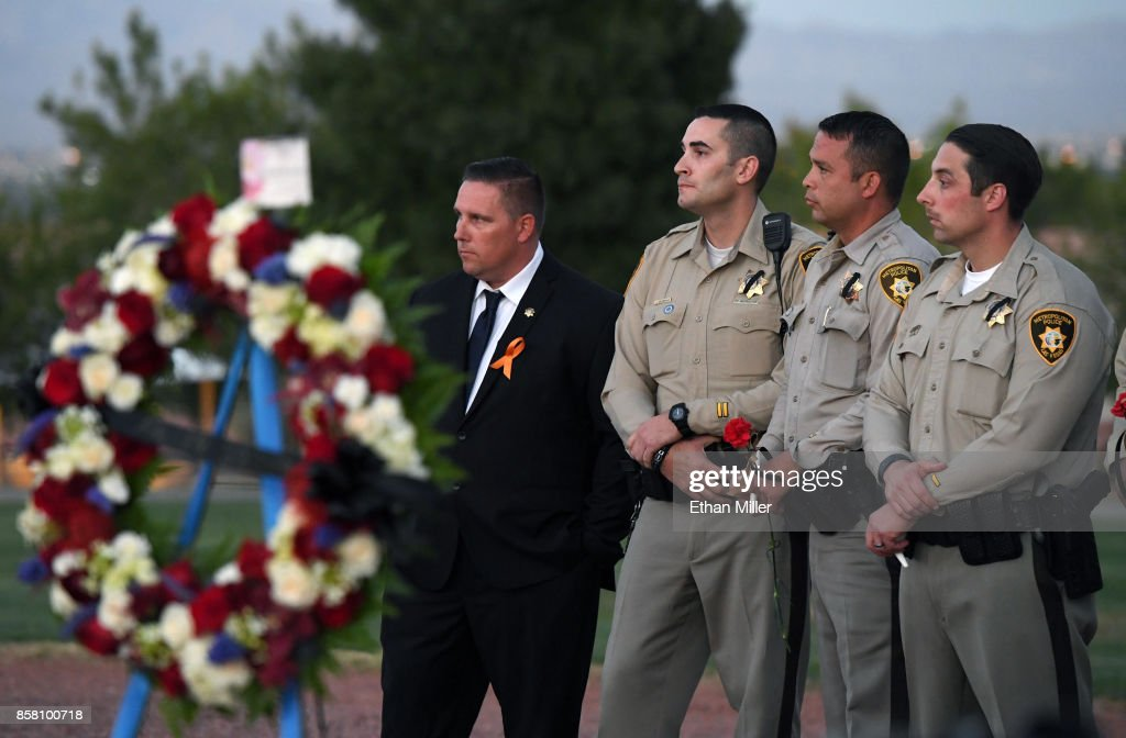 Members of the Las Vegas Metropolitan Police Department attend a vigil for Las Vegas Metropolitan Police Department Officer Charleston Hartfield at Police Memorial Park on October 5, 2017 in Las Vegas, Nevada. Hartfield, who was off duty at the Route 91 Harvest country music festival on October 1, was killed when Stephen Paddock opened fire on the crowd killing at least 58 people and injuring more than 450. The massacre is one of the deadliest mass shooting events in U.S. history.