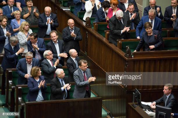 Members of the Law and Justice rulling party with its leader Jaroslaw Kaczynski during a night debate on a Supreme Court bill in the lower house of...
