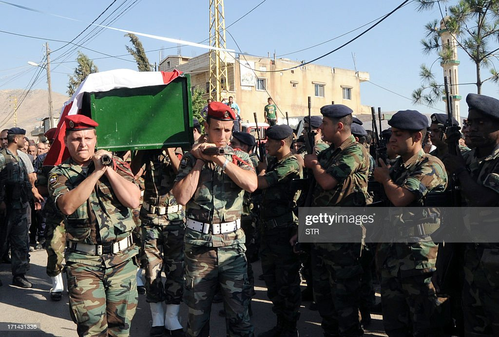 Members of the Lebanese armed forces carry the coffin of a comrade who was killed during clashes with supporters of a radical Sunni cleric, during his funeral procession in Faour, in Lebanon's Bekaa valley, on June 24, 2013. The violence is among the worst in Lebanon since the start of the Syrian conflict, which has inflamed sectarian tensions in the country, particularly between Shiite supporters of the Damascus regime and Sunni backers of the uprising.