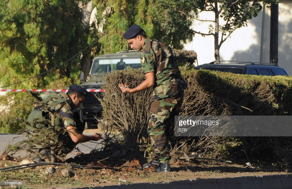 Members of the Lebanese armed forces search for evidence on June 28, 2013 following a road side bombing attack on trucks that were linked to the militant Shiite movement Hezbollah early in the morning in the central city of Zahle in the Lebanese Bekaa Valley. Lebanon remains deeply divided between opponents President Bashar al-Assad and supporters of his regime, which is being aided militarily by the Hezbollah group.