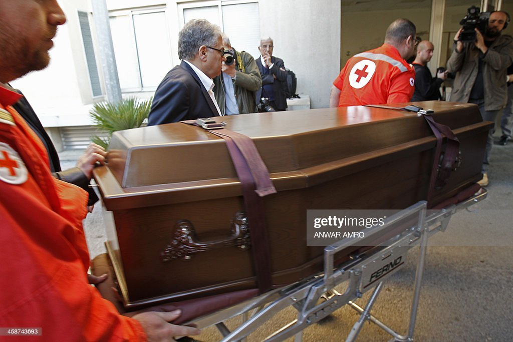 Members of the Lebanese Red Cross carry the coffin of Abbas Khan, the British doctor who died in a Syrian jail, as it arrives at the Hotel Dieu hospital in the capital Beirut after it was brought to Lebanon from Syria on December 21, 2013. The British government has held Damascus responsible for the death of the 32-year-old orthopaedic surgeon but Syrian authorities said that Khan was found 'hanging' in his cell, where he was being held for 'unauthorised activities,' and that he had committed suicide.
