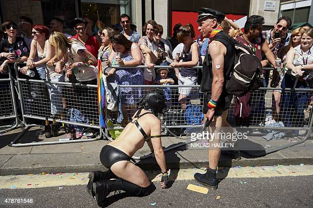 Members of the Lesbian Gay Bisexual and Transgender community take part in the annual Pride Parade in London on June 27 2015 AFP PHOTO / NIKLAS...