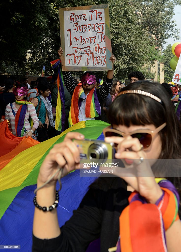 Members of the lesbian, gay, bisexual, transgender (LGBT) community and supporters attend the 5th Delhi Queer Pride parade in New Delhi on November 25, 2012. Marching in solidarity and in celebration of their diversity, the LGBT community demanded equal legal, social and medical rights.