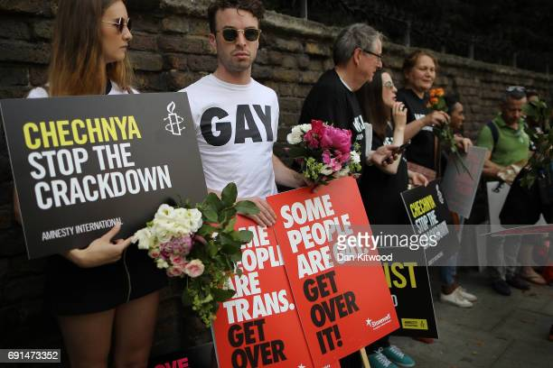Members of the LGBT community and Amnesty International campaigners stage a protest over LGBT rights in Chechnya outside the Russian Embassy on June...