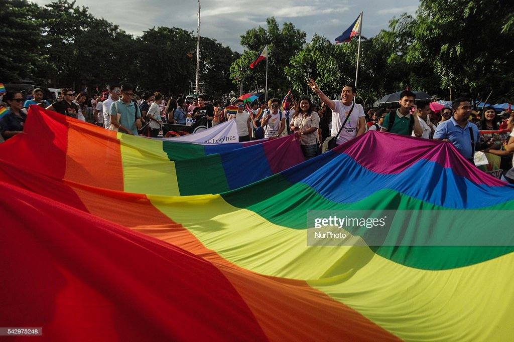 Members of the LGBT community hold a large rainbow flag during an LGBT pride march at Rizal Park in Manila on Saturday, 25 June 2016. Hundreds of supporters and members of the lesbian, gay, bisexual, and transgender (LGBT) community paraded in Manila calling for the passage of an anti-discrimination law, as well as calling for justice for the shooting in a gay club in Orlando that left 53 people dead.