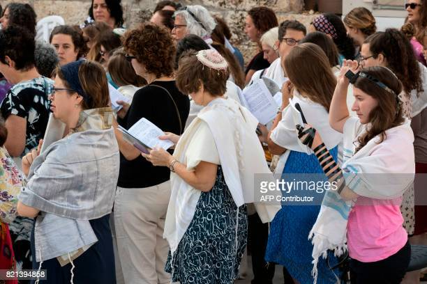 Members of the liberal Jewish religious group Women of the Wall wear phylacteries and traditional Jewish prayer shawls for men known as 'Tallit' as...