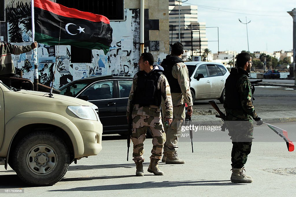 Members of the Libyan security forces patrol the streets near Revolution square in the eastern coastal city of Benghazi on February 15, 2013. Libya on February 17, will mark the second anniversary of the uprising that toppled the regime of strongman Moamer Kadhafi, amid fears of fresh violence and calls for demonstrations across the country.