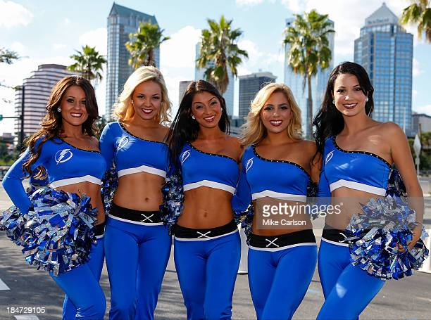Members of the Lightning Girls the cheerleading team of the Tampa Bay Lightning pose during festivities for the team's home opener against the...