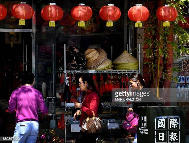 Members of the local Asian community walk on the streets of Chinatown in Los Angeles California on March 29 2017 Of the estimated 11 million...
