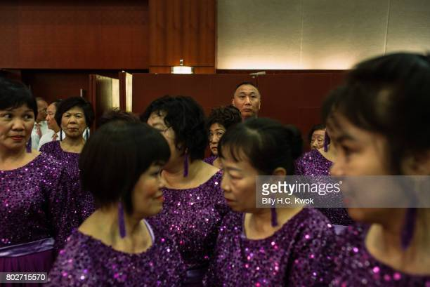 Members of the local chamber of commerce celebrate ahead of 20th anniversary of the handover from Britain to China on June 8 2017 in Hong Kong Hong...