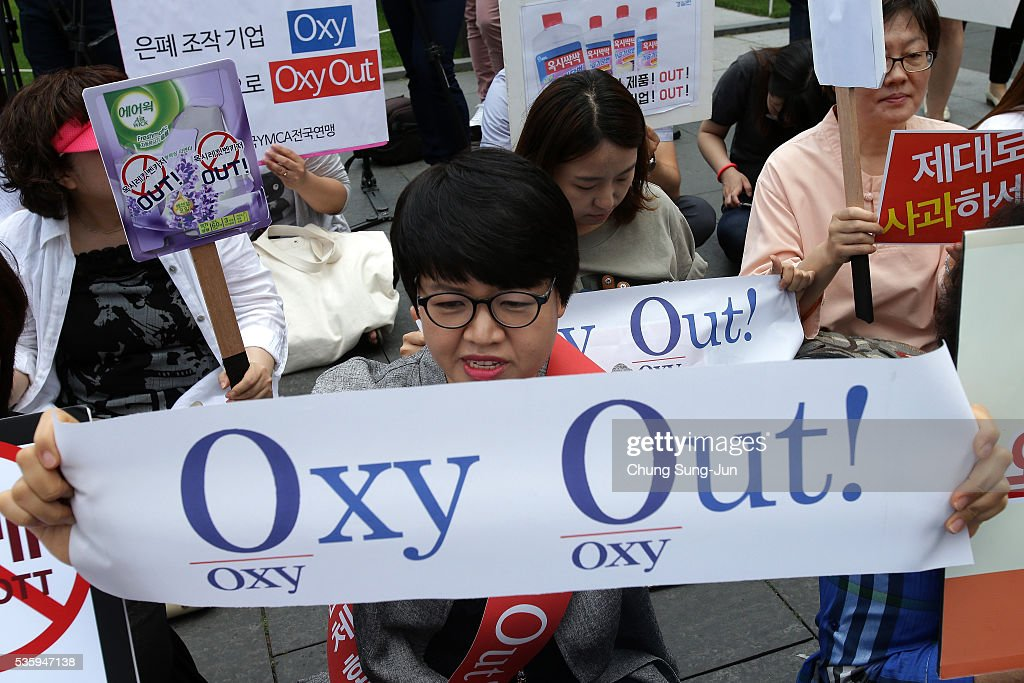 Members of the local civic group Korea Federation for Environmental Movements participate in anti-Oxy Reckitt Benckiser protest at Oxy headquarter on May 31, 2016 in Seoul, South Korea. Protesters hold a anti-Oxy Reckitt Benckiser rally to launch a boycott campaign against the British firm's products in front of Oxy headquarter in South Korea.