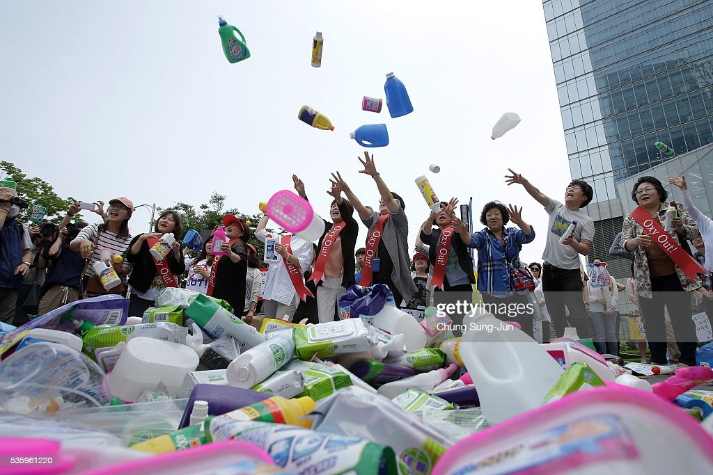 Members of the local civic group Korea Federation for Environmental Movements throw goods from Oxy Reckitt Benckiser at Oxy headquarter on May 31, 2016 in Seoul, South Korea. Protesters hold a anti-Oxy Reckitt Benckiser rally to launch a boycott campaign against the British firm's products in front of Oxy headquarter in South Korea.
