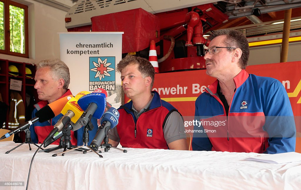 Members of the local fire brigade and rescue team speak with the media at their coordinating center near an underground cave where an explorer is lying injured 1,000 meters below on June 11, 2014 near Marktschellenberg, Germany. The man, along with two colleagues, was exploring the Riesending vertical cave, which is over 20km long and up to 1,148 meters deep, when he was struck by rocks and severely injured. Since then specialist rescue workers from Switzerland and Italy have arrived to help with the arduous rescue effort, which could take up to several more days and even weeks.