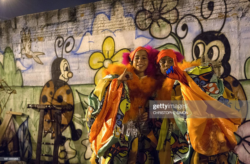 Members of the local 'Indio' carnival group of the Guadalupe neighborhood in northern Rio de Janeiro, Brazil, await to take part in their 'Bate Bola' traditional parade on February 10, 2013. AFP PHOTO/Christophe Simon