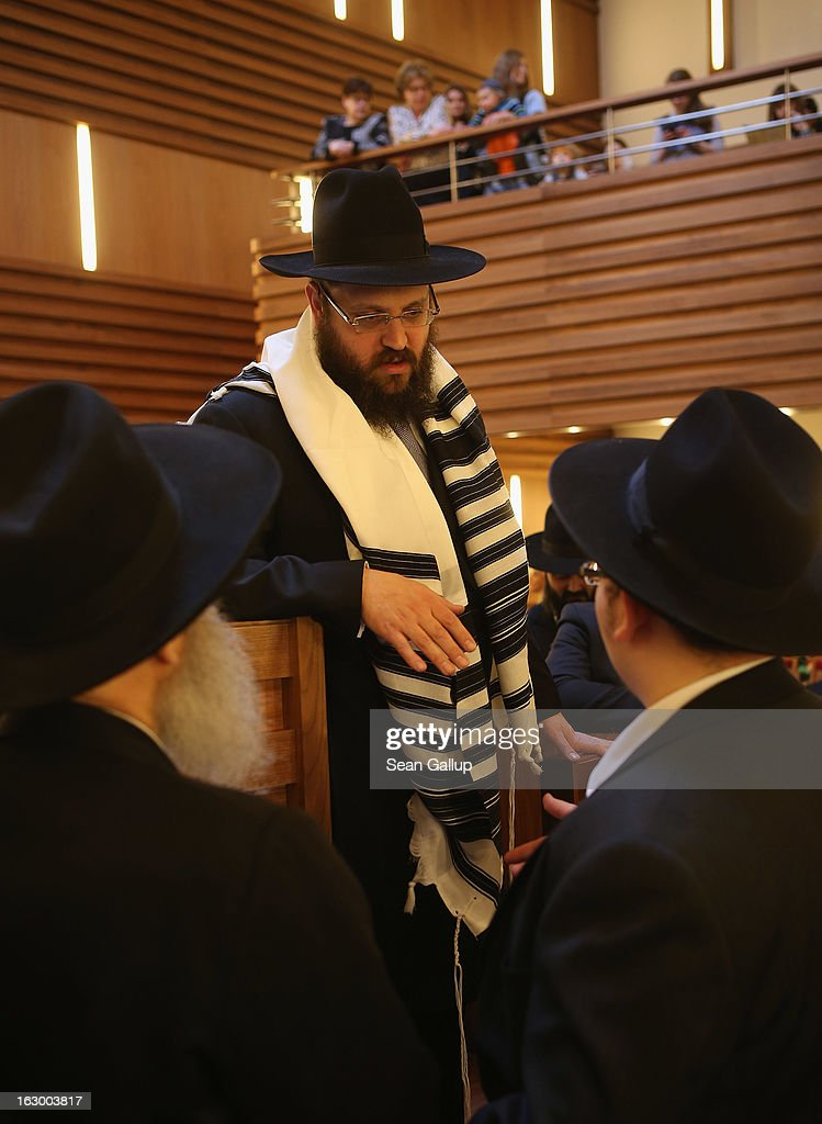 Members of the local Orthodox Jewish community greet Rabbi Yehuda Teichtal (C) prior to the circumcision ceremony of his son at the Chabad Lubawitsch Orthodox Jewish synagogue on March 3, 2013 in Berlin, Germany. Germany's parliament, the Bundestag, passed a law affirming the legality of circumcision in December after a Cologne court called the practice into question in May of 2012, a ruling that sparked outrage among Germany's Jewish and Muslim population.