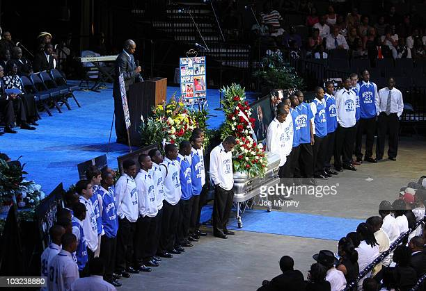 Members of the local YMCA surround the casket of Lorenzen Wright during a memorial service honoring the life of Lorenzen Wright on August 4 2010 at...