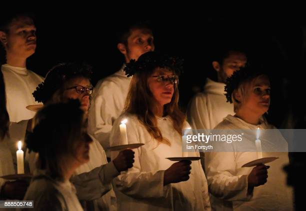 Members of the London Nordic Choir perform during the Sankta Lucia festival of Light service at York Minster on December 8 2017 in York England The...