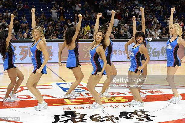 Members of the Los Angeles Clippers dance team perform before a game between the Los Angeles Clippers and the Charlotte Hornets as part of the 2015...
