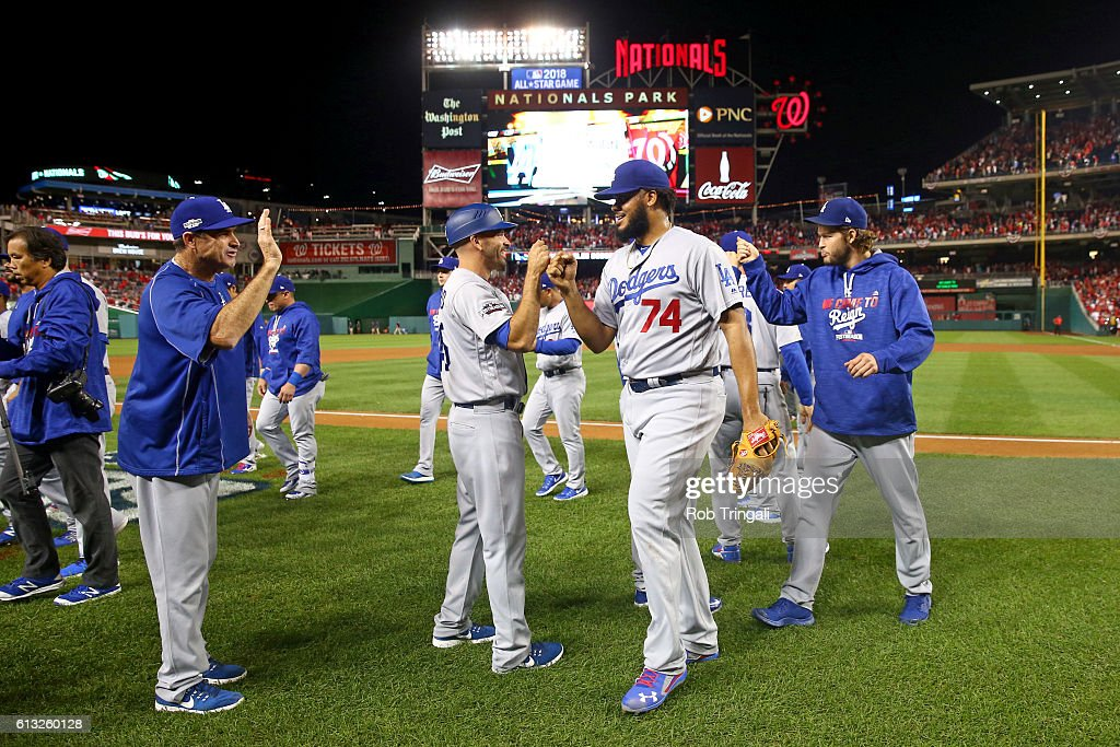 Members of the Los Angeles Dodgers celebrate defeating the Washington Nationals in Game 1 of NLDS at Nationals Park on Friday, October 7, 2016 in Washington, D.C.