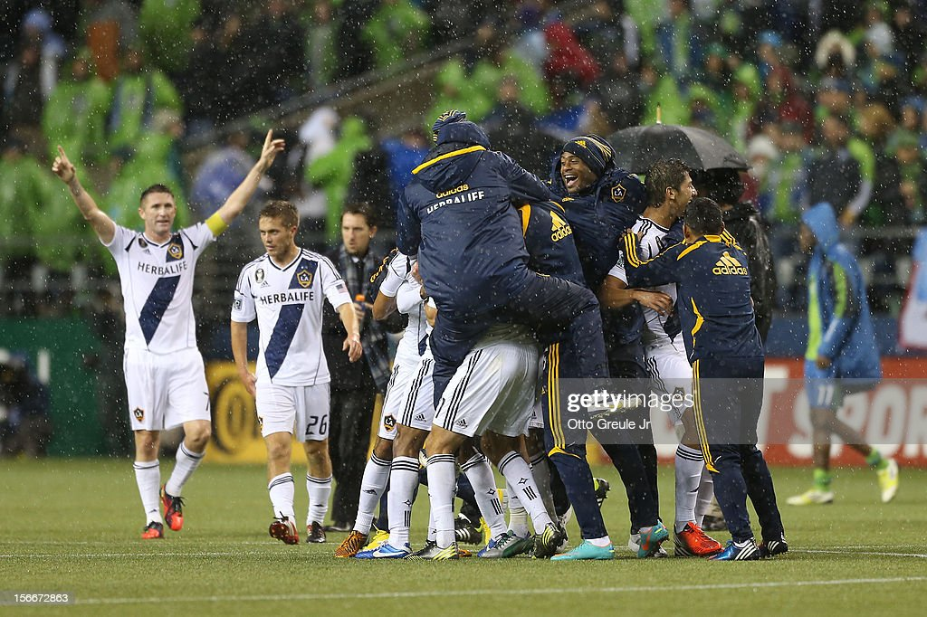 Members of the Los Angeles Galaxy celebrate after defeating the Seattle Sounders 2-1, winning the aggregate playoff 4-2 during Leg 2 of the Western Conference Championship at CenturyLink Field on November 18, 2012 in Seattle, Washington.