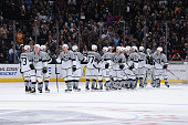 Members of the Los Angeles Kings celebrate a victory over the San Jose Sharks at STAPLES Center on April 11 2015 in Los Angeles California