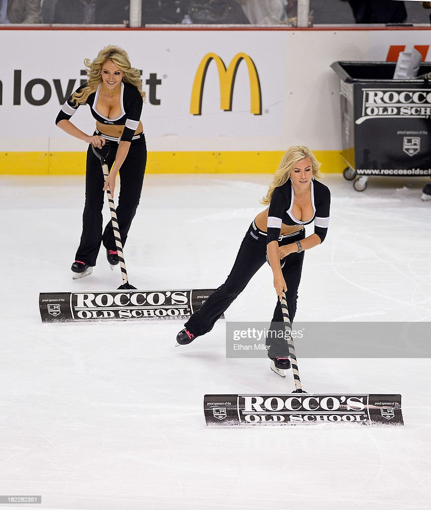 Members of the Los Angeles Kings ice girls Ashley Covert (L) and Allison 'Ally' Mello clean the ice during the team's preseason game against the Colorado Avalanche at the MGM Grand Garden Arena on September 28, 2013 in Las Vegas, Nevada. Covert and Mello team up to compete on the new season of the reality television game show 'The Amazing Race.'